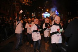 "People wearing Hillary Clinton and Bernie Sanders masks march with along a float called ""The Squished Penises"" during the 43rd annual Village Halloween Parade in New York City on Oct. 31, 2016. (Gordon Donovan/Yahoo News)"