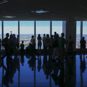Visitors are reflected in the floor as they photograph the amazing views from observatory on the 100th floor of One World Trade Center in New York City on Tuesday, Aug 23, 2016. (GordonDonovan/Yahoo News)