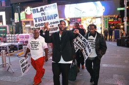 Supporters of Donald Trump hold up signs as they make their way through Times Square in New York City on Nov. 9, 2016. (Gordon Donovan/Yahoo News)