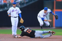 New York Mets 2nd baseman Wilmer Flores (4) fires a throw to 1st base in the second inning of a baseball game against the Miami Marlins at Citi Field in New York, Tuesday, July 5, 2016. (Gordon Donovan)
