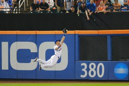 New York Mets Justin Ruggiano (1) leaps but can't make the catch in the fourth inning of a baseball game against the Colorado Rockies at Citi Field in New York, Saturday, July 30, 2016. (Gordon Donovan)