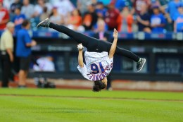 U.S. Olympic Gold Medal gymnast Laurie Hernandez threw the first pitch out in her own unique way before the baseball game between the Washington Nationals and New York Mets at Citi Field at New York, Saturday, Sept. 3, 2016. (Gordon Donovan)