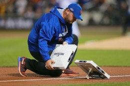 New York Mets grounds crew manager Ryan Woodley changes bases in between innings during the National League wild-card baseball game against the San Francisco Giants at Citi Field in New York, Wednesday, October 5, 2016. The Giants beat the Mets 3-0 to advance to the NLDS. (Gordon Donovan)