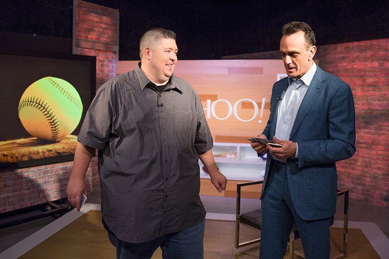 Yahoo MLB columnist Mike Oz of Big League Stew opens packs of 1992 Topps baseball cards with actor Hank Azaria during an interview at the Yahoo Studios in New York City on April 5, 2017. (Gordon Donovan/Yahoo News)