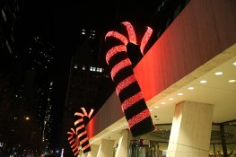 Giant candy canes hang outside an office building on W. 57th St. in New York City. (Gordon Donovan/Yahoo News)