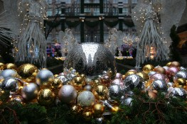 Raindrops cover the ornaments in the Garden with a relection of Rockefeller Center. (Gordon Donovan/Yahoo News)