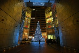 A person takes a photo of the Christmas tree at the Bloomberg Tower in New York City. (Gordon Donovan/Yahoo News)