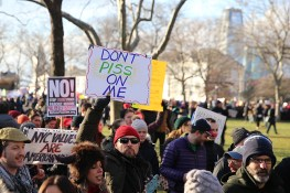 A man holds up a sign during a rally in New York's Battery Park on Jan. 29, 2017, protesting President Donald Trump's immigration order. (Gordon Donovan/Yahoo News)