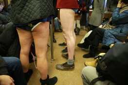 Passengers try to block out people take art taking part in the No Pants Subway Ride in New York City, Sunday, Jan. 8, 2017. The 'No Pants Subway Ride' is an annual event that has become a global celebration of bare thighs. The 'celebration of silliness' is designed to make other subway riders smile. (Gordon Donovan/Yahoo News)