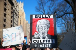 "Demonstrator carries an anti-Trump sign during the ""Not My President's Day"" rally at Central Park West in New York City on Feb. 20, 2017. (Gordon Donovan/Yahoo News)"