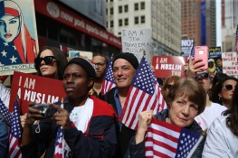 "Participants hold signs and flags at the ""I am a Muslim too"" rally at Times Square in New York City on Feb. 19, 2017. (Gordon Donovan/Yahoo News)"