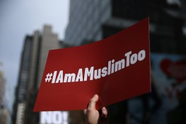 "A protester holds up signs at the ""I am a Muslim too"" rally at Times Square in New York City on Feb. 19, 2017. (Gordon Donovan/Yahoo News)"