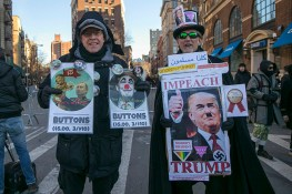 Two men sell buttons at a rally in front of the Stonewall Inn in solidarity with immigrants, asylum seekers, refugees, and the LGBT community, Feb. 4, 2017 in New York. (Photo: Gordon Donovan/Yahoo News)
