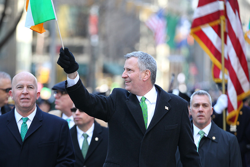 New York City Mayor Bill de Blasio waves a flag while marching in the St. Patrick's Day Parade, March 17, 2017, in New York. (Gordon Donovan/Yahoo News)