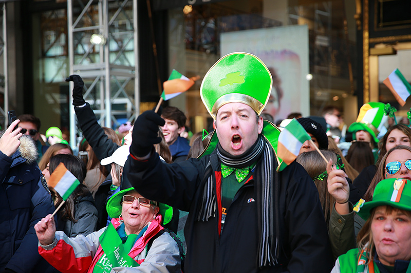 Participants celebrate while watching marchers in the St. Patrick's Day Parade, March 17, 2017, in New York. (Gordon Donovan/Yahoo News)