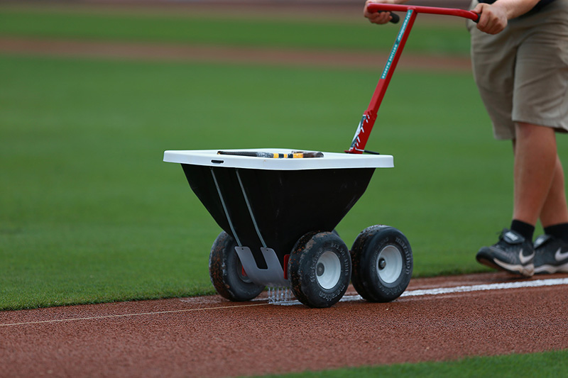 A grounds crew member prepares the 3rd base line before the spring training baseball game against the New York Mets and St. Louis Cardinals at Roger Dean Stadium in Jupiter, Fl., Wednesday, March 1, 2017. (Gordon Donovan/Yahoo Sports)