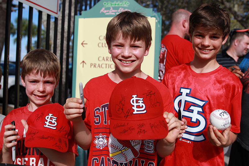 A group of young St. Louis Cardinals fans hold up autographs while standing outside the players gate after the spring training baseball game against the New York Mets at Roger Dean Stadium in Jupiter, Fl., Wednesday, March 1, 2017. (Gordon Donovan/Yahoo Sports)