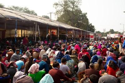 Devotees listening to HH Dalai Lama