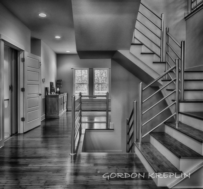 Black and white photograhic image of an internal stairway, by photographer Gordon Kreplin.