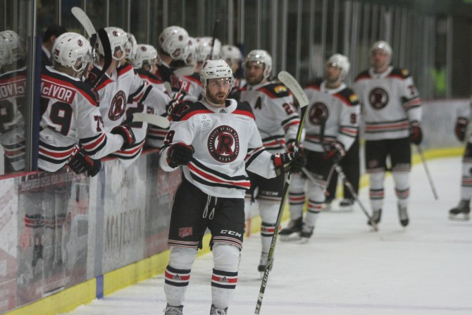 The UNB Reds celebrate Brady Gilmour's first period goal in Saturday's 7-3 win at Moncton. (Photo: Moncton Athletics)