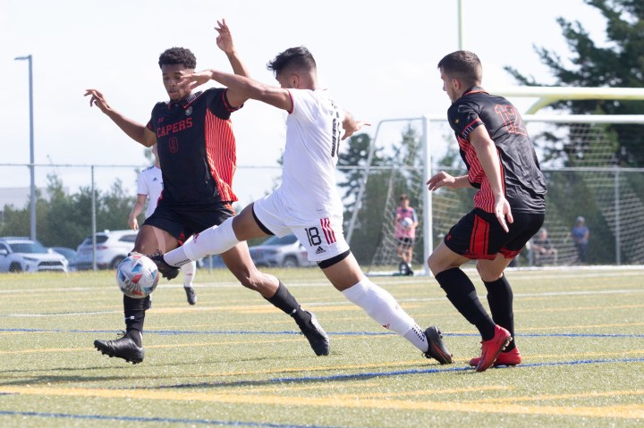 REDS fullback Bilal Mehran intercepts a Capers pass during Saturday's 4-2 UNB win over Cape Breton. (PHOTO: James West/for UNB Athletics)