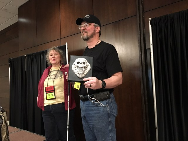 The Harmons reveal the Grandmaster Award trophy for Michael R. Collings during the opening ceremonies. What a plaque!