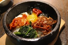 A korean rice dish in a hot bowl