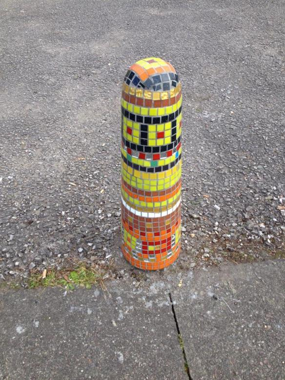 Yellow and black mosaicked bollard