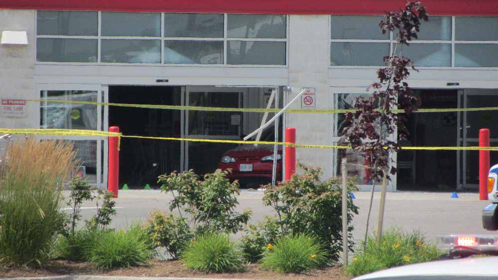 View of the front entrance to the London Costco store on July 24, 2014 where a red Monte Carlo is seen after it reversed resulting in the death of two children.