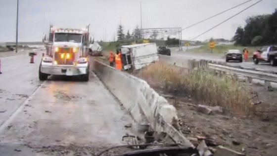 Barrier Impacts Causing Rollovers of Large Vehicles
