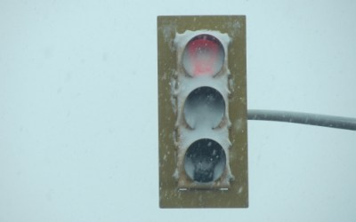Dangerous LED Traffic Signals Covered By Snow Cause Vehicles to Pass Through a Red Light