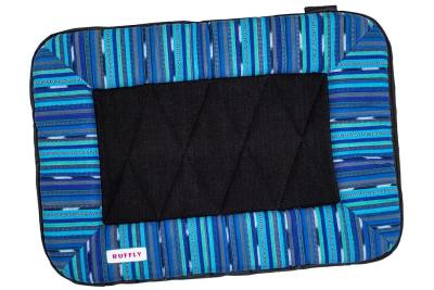Top view of small dog travel bed with blue handwoven top and rugged durable waterproof bottom