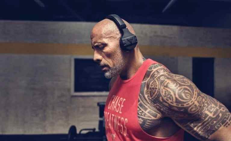 rock wearing headphones