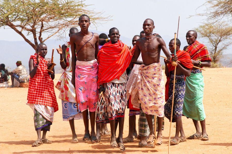 Masai Mara tribe dancing. 4 Incredible Things that Make Up the Masai Mara Experience. Gosheni Safaris
