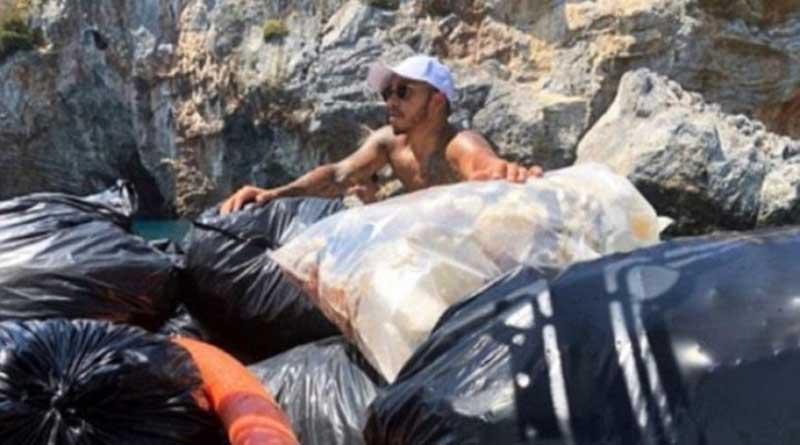 """Ο πασίγνωστος """"πιλότος"""" της F1  Λιούις Χάμιλτον μαζεύει σκουπίδια από τις παραλίες της Μυκόνου"""