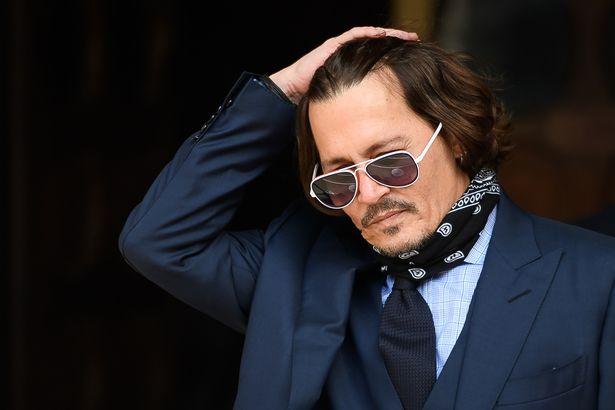 Johnny Depp outside court in July
