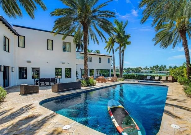 It's got its own swimming pool surrounded by palm trees
