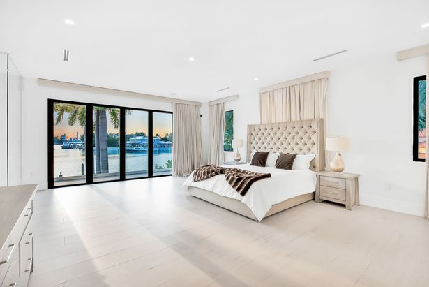 The master bedroom has beautiful views of the water