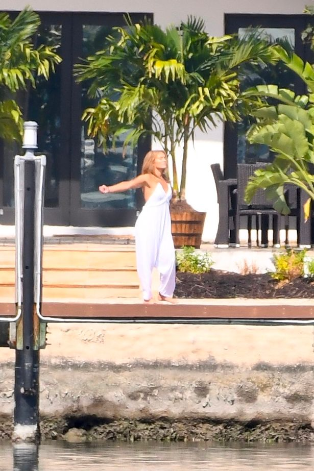Jennifer Lopez was seen spreading her arms with joy on the terrace of her $18m Miami love nest