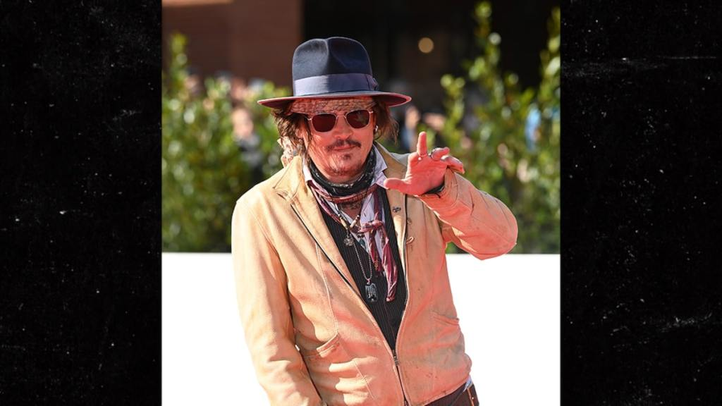 Johnny Depp Mobbed by Adoring Fans at Rome Film Festival, Gives Thanks