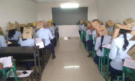 students wear boxes on their heads during exam to prevent cheating