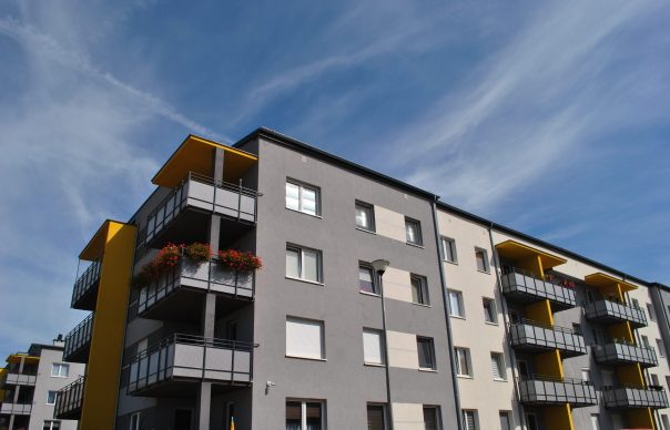 Multifamily apartment community building with blue sky