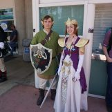 A familiar Link and Zelda from The Legend of Zelda: Twilight Princess return to SDCC, sans the sunglasses.