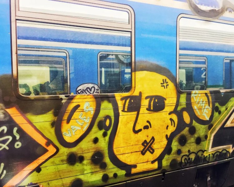 The trains in Greece are all decorated with street art