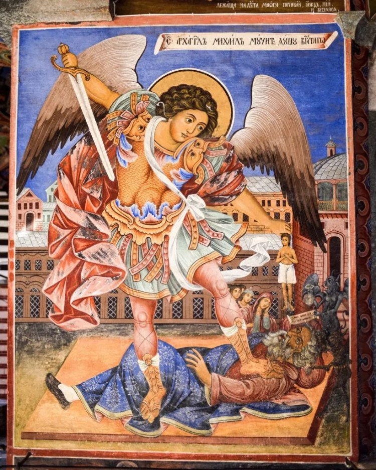 A fresco on the outside of the church depicting the Arch Angel Michael