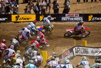 Pack of 450's funnel through the 2nd turn (supercross.com photo)
