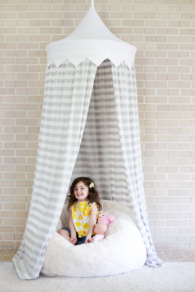 """Create a small reading nook or some """"me"""" space for your little one with this Hula Hoop Tent tutorial by A Beautiful Mess. -Sewtorial"""