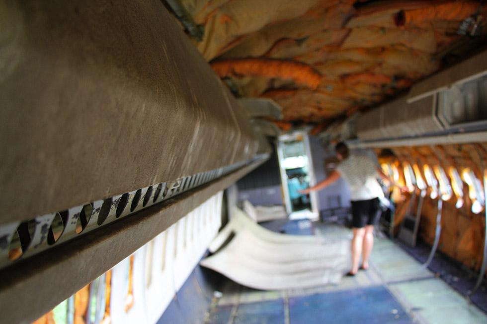 Wandering around the stripped cabin - Airplane Graveyard in Bangkok