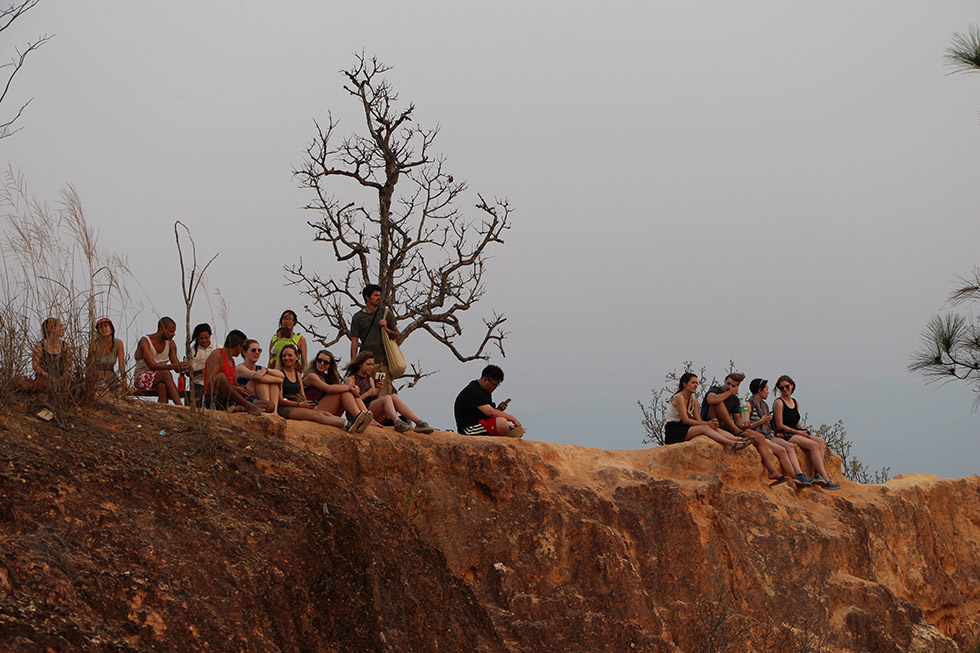 Tourists catching the sunset - Pai Canyon
