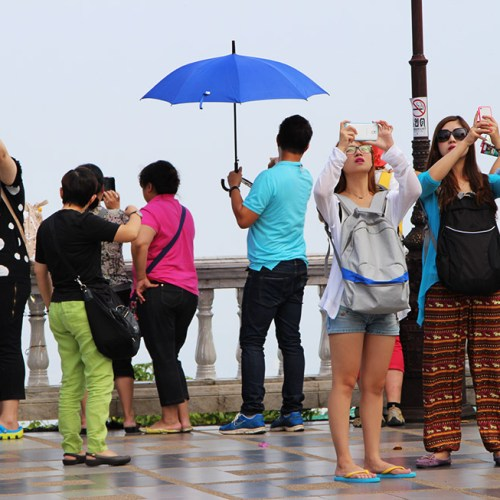Tourist snapping away at Doi Suthep in Chiang Mai